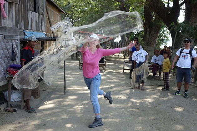 tourist learning how to use fishing net in Hsithe