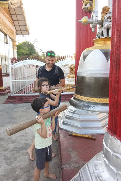 kids ring the bell in Myanmar family holiday